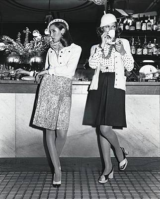 Models Wearing Cloche Hats At A Bar Poster