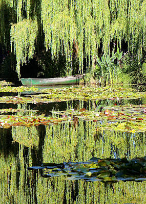 Poster featuring the photograph Monet's Pond by Lorella  Schoales