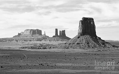 Monument Valley Arizona Sanstone Monoliths Rising Up Above Desert Floor Black And White Poster by Shawn O'Brien