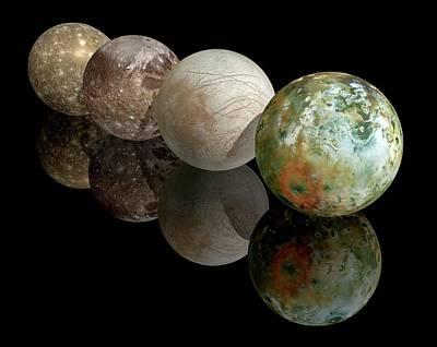 Moons Of Jupiter Poster by Carlos Clarivan
