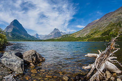 Morning Colors Of Swiftcurrent Lake Poster by Greg Nyquist