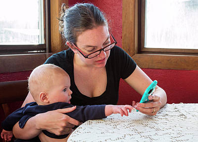 Mother And Baby Using A Mobile Device Poster by Jim West