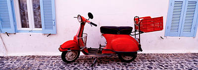 Motor Scooter Parked In Front Poster
