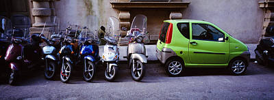 Motor Scooters With A Car Parked Poster