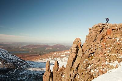 Mountaineer On A Rocky Granite Outcrop Poster