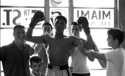 Muhammad Ali Raising Arms Poster by Retro Images Archive