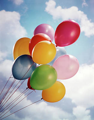 Multiple Colored Balloons Against Blue Poster