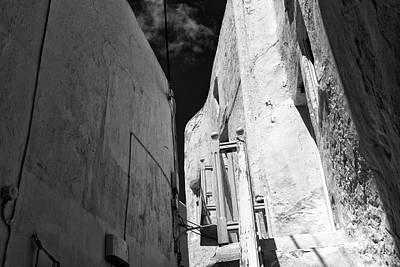 Mykonos Town White Buildings Mono Poster by John Rizzuto