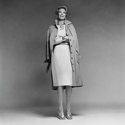 Nan Kempner Wearing A Coat And Dress Poster by Francesco Scavullo