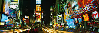 Neon Boards In A City Lit Up At Night Poster by Panoramic Images