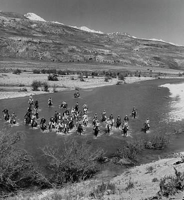 Nomadic Tribesmen Cross A River In Iran Poster