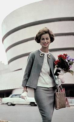 Norma Collier Standing In Front Of The Guggenheim Poster