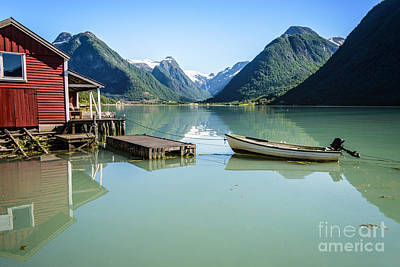 Reflection Of A Boat And A Boathouse In A Fjord In Norway Poster