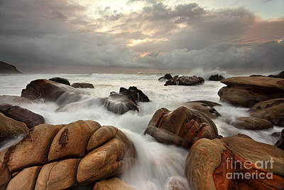 Ocean Surges Over Weathered Rocks Poster