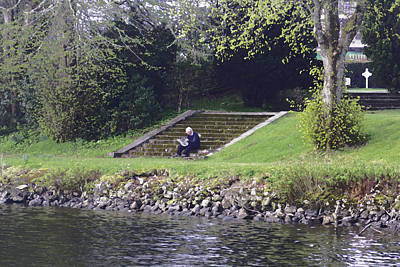 Oil Painting - Man Sitting On Steps Reading Paper On Shore Of Loch Ness Poster