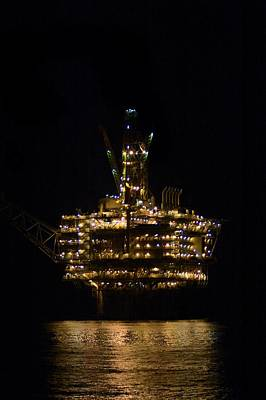 Oil Production Platform At Night Poster by Bradford Martin