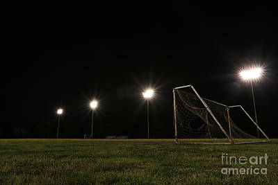Old Grunge Soccer Goal On A Lit Field At Night Poster