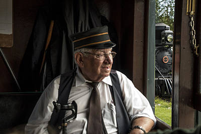 Old Train Conductor Poster by Randall Nyhof