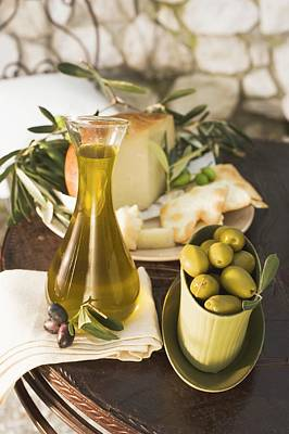 Olives, Olive Oil, Cheese And Crackers On Table Out Of Doors Poster