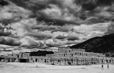 Ominous Clouds Over Taos Pueblo Poster by Silvio Ligutti