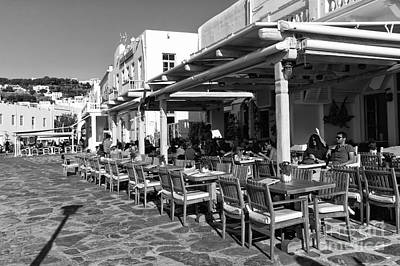 Outdoor Cafe In Mykonos Town Mono Poster by John Rizzuto