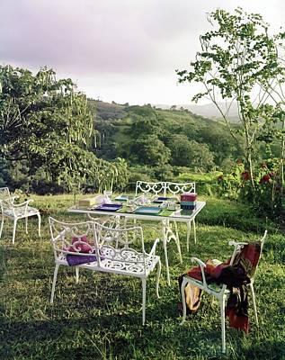Outdoor Furniture By Lloyd On Grassy Hillside Poster by Tom Leonard