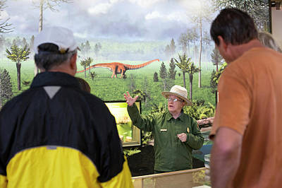 Park Ranger At A Dinosaur Exhibit Poster by Jim West
