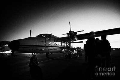 Passengers Boarding Early Morning Dehaviland Twin Otter Light Aircraft Flight To Grand Canyon At Bou Poster by Joe Fox