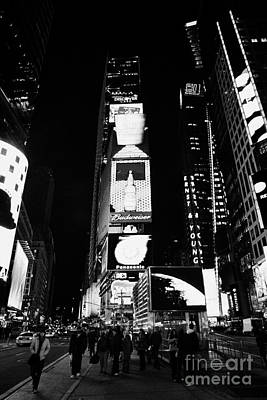 Pedestrians Walk In The Centre Of Times Square In Nighttime New York City Poster by Joe Fox