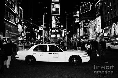 Pedestrians Walk Past Yellow Cab Stationary In The Middle Of Times Square At Night New York City Poster