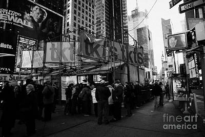 people customers queuing outside the tickets TKTS booth in times square new york city Poster by Joe Fox