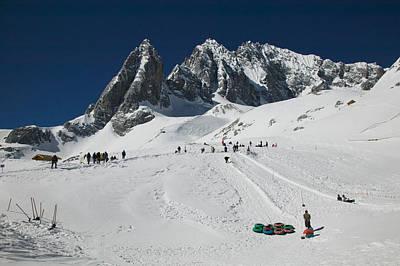 People Enjoying Snow Tubing At Jade Poster