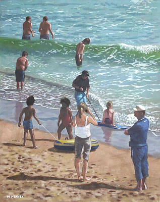 people on Bournemouth beach pulling dingys Poster by Martin Davey