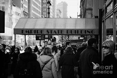 People On The Sidewalk Beneath The Entrance To The Empire State Building On Fifth Avenue New York Poster