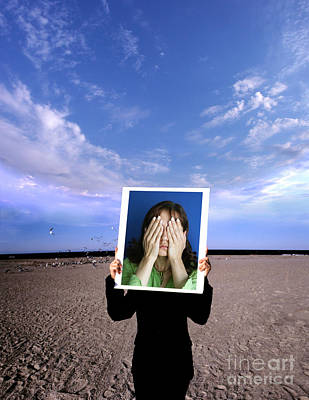 Person Holding Photo Poster by Novastock