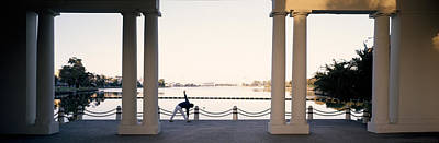 Person Stretching Near Colonnade, Lake Poster by Panoramic Images