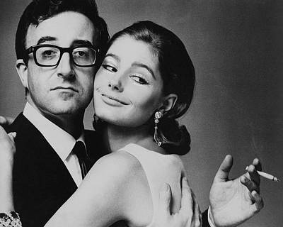 Peter Sellers Posing With A Model Poster