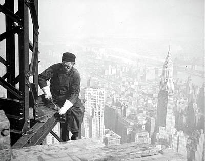 Photograph Of A Workman On The Framework Of The Empire Poster