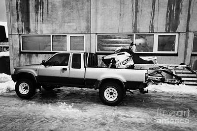 pickup truck parked carrying snowmobile Honningsvag finnmark norway europe Poster by Joe Fox