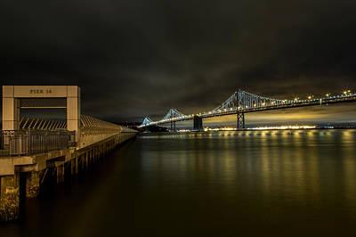Pier 14 And Bay Bridge At Night Poster by John Daly