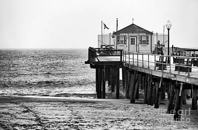 Pier In Winter Poster by John Rizzuto