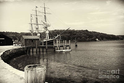Pier With A Tall Ship Poster by George Oze