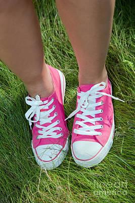 Pink Sneakers On Girl Legs On Grass Poster by Michal Bednarek