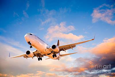 Plane Flying In Sunset Sky Poster