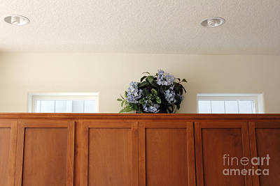 Plastic Flowers On Cabinets Poster