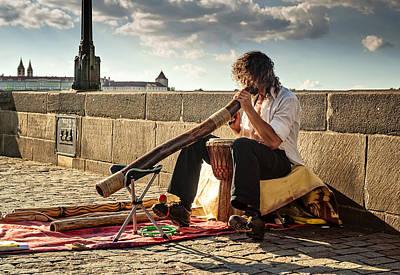 Playing Didgeridoo On The Charles Bridge. Prague Poster by Jenny Rainbow