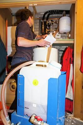Plumber Fills A Solar Thermal Panel Poster