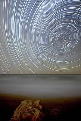 Polar Star Trails Over Coastal Waters Poster