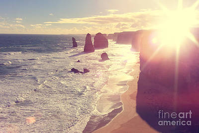Port Campbell National Park Twelve Apostles With Sun Flare Poster by Beverly Claire Kaiya