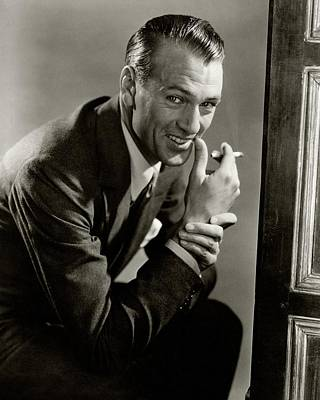 Portrait Of Gary Cooper Holding A Cigarette Poster by Lusha Nelson